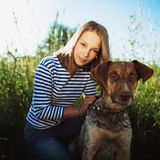 Beautiful girl with dog Royalty Free Stock Photography
