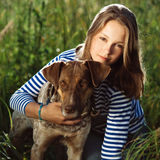 Beautiful girl with dog Royalty Free Stock Photo