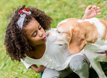 Beautiful girl with a dog Stock Image