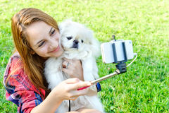 Beautiful girl with dog taken pictures of her self. Instagram Stock Photography