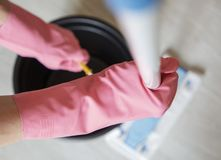 Beautiful girl doing wet cleaning and vacuuming royalty free stock photos