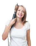 Beautiful girl doing hairstyle with hair brush Stock Photo