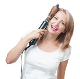 Beautiful girl doing hairstyle with hair brush Royalty Free Stock Image