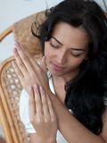 Beautiful girl doing a hand massage at home Stock Photography