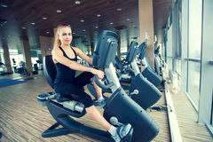 Beautiful girl doing indoor biking in a fitness. Club Stock Photo