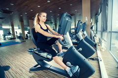 Beautiful girl doing indoor biking in a fitness. Club Royalty Free Stock Photo