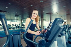 Beautiful girl doing indoor biking in a fitness Stock Image
