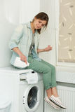 Beautiful girl doing laundry Stock Images