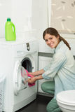 Beautiful girl doing laundry Royalty Free Stock Image