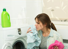 Beautiful girl doing laundry Royalty Free Stock Photography