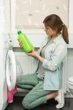 Beautiful girl doing laundry Stock Photo