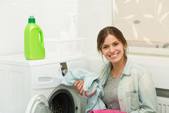 Beautiful girl doing laundry Royalty Free Stock Image