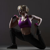 Beautiful girl doing lunges Stock Photography