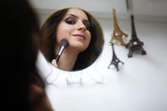 Beautiful girl doing makeup Royalty Free Stock Image