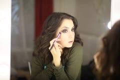Beautiful girl doing makeup Royalty Free Stock Images