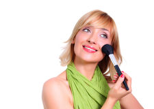Beautiful girl doing makeup. Isolated on white background Royalty Free Stock Photos