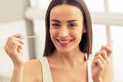 Beautiful girl doing makeup stock image