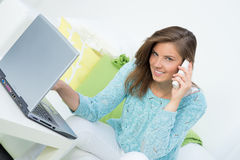 Beautiful girl doing online shopping Stock Images