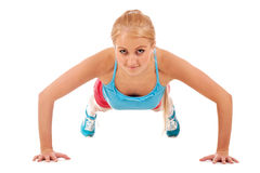 Beautiful girl doing push-ups Royalty Free Stock Photography