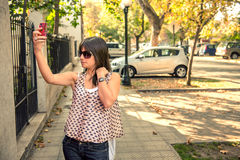 Beautiful girl doing a self portrait in the city. Great Urban shot Stock Images