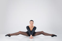 Beautiful girl doing side split. Stock Image