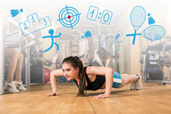 Beautiful girl doing some push ups at the gym Royalty Free Stock Images