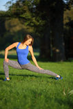 Beautiful girl doing stretching outside in the park Royalty Free Stock Photo