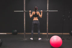 Beautiful girl doing workout in the gym Royalty Free Stock Image