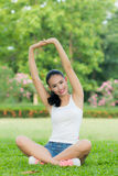 Beautiful girl doing a workout in the park Royalty Free Stock Photography