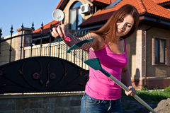 Beautiful girl doing yardwork. On a bright Spring day Royalty Free Stock Image