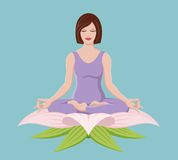 Beautiful girl doing Yoga. A beautiful woman does yoga in the lotus position while nestled into the petals of a lotus flower Royalty Free Stock Photography
