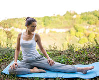 Beautiful girl doing yoga exercise outdoors Stock Photos