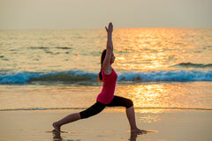 Beautiful girl doing yoga near the ocean Royalty Free Stock Photos