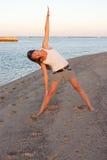 Beautiful girl doing yoga near sea Stock Image