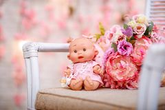 Beautiful girl, doll with flowers, floral wreath.The fashion con. Beautiful girl, doll with flowers, floral wreath, bouquet, tied bows, butterly and sparkles Stock Photo