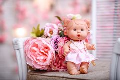 Beautiful girl, doll with flowers, floral wreath.The fashion con. Beautiful girl, doll with flowers, floral wreath, bouquet, tied bows, butterly and sparkles Royalty Free Stock Photo