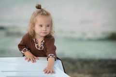 Beautiful girl with Down syndrome on the beach stock image