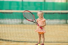 Beautiful girl with Down syndrome playing tennis royalty free stock image