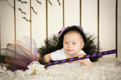 Beautiful girl with Down syndrome in a suit of the sorceress with a broom. Beautiful girl with Down syndrome  in a suit of the sorceress with a broom Stock Photo