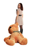 Beautiful girl draging toy bear Royalty Free Stock Photography