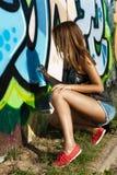 Beautiful girl is drawing graffiti Royalty Free Stock Photo