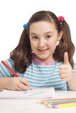 Beautiful girl drawing and showing OK Stock Photography
