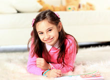 Beautiful girl draws Stock Image