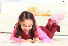 Beautiful girl draws Royalty Free Stock Photography