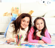 Girl draws with his mother Royalty Free Stock Images