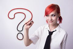 Beautiful girl draws a question mark marker Stock Photography