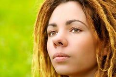 Beautiful girl with dreadlocks royalty free stock photos