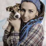 Beautiful girl with dreadlocks and dog puppy Jack Russell terrie Stock Photos