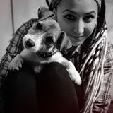 Beautiful girl with dreadlocks and dog puppy Jack Russell terrie Royalty Free Stock Photo