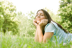 Beautiful girl dreaming outdoor Royalty Free Stock Photography